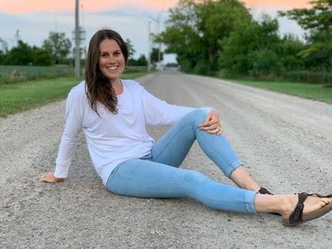 me sitting on a dirt road ready to have a mom to mom chat